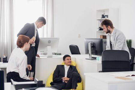 Office workers have a break time and talk during working day in the office