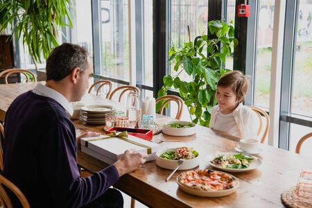 Family of two having a celebration in a cafe