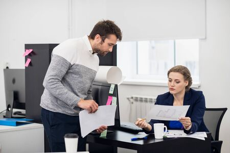 An employee carefully listening to his supervisor, who is explai Stock Photo