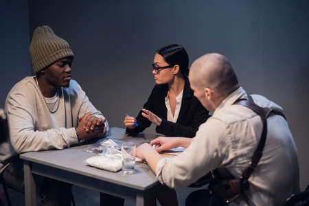 A drug dealer detained with a package containing an unknown white substance is interrogated by an experienced investigator in the presence of a lawyer.