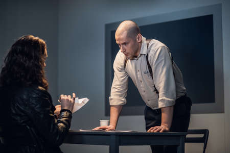 During the interrogation, the criminal tore up the document.