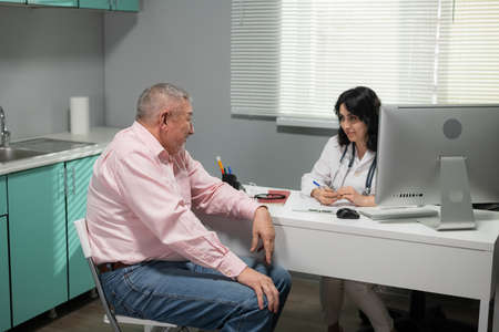 A practitian explaining to her patient the treatment measures.