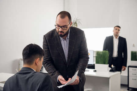 An experienced senior Manager explains the nuances of their work to a new employee. Hints, tips, and training.