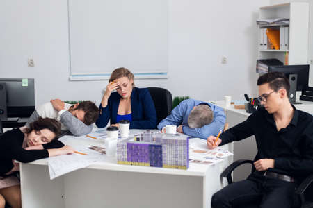 Exhausted architect team on a tiring meeting. Tough decision making, hard choices.
