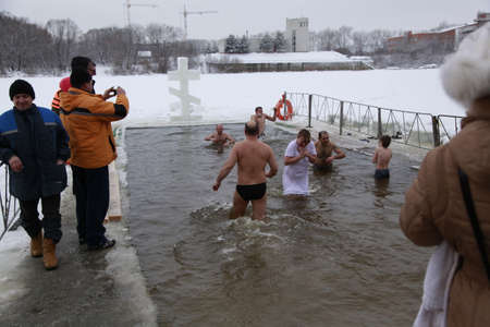 People plunge into icy water in the feast of the Baptism of the Lord Jesus Christ. Bryansk, Russia, January 19, 2013
