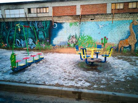 Wall with graffiti on the Playground. Фото со стока