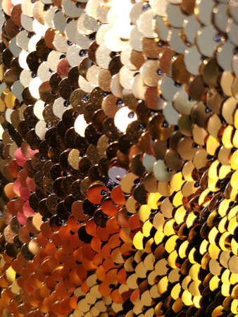 Backgrounds and abstraction. Gold-tone round sequin fabric