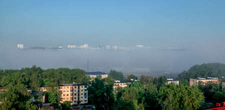 View of the city in the fog, which seems to float in the clouds. Stock fotó