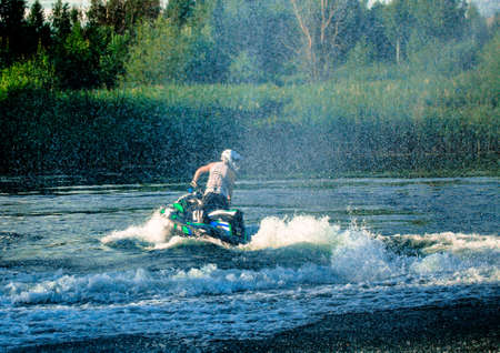 06 28 2019 Russia, Byansk. Very fine splashes of water after demonstrating the turn of the jet ski. Sajtókép