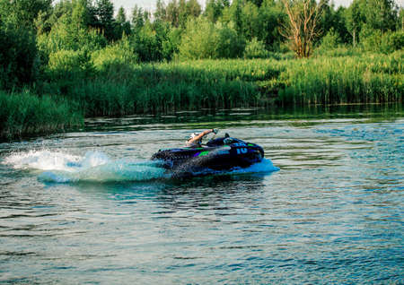 06 28 2019 Russia, Byansk. The pilot on a jet ski comes into a turn.