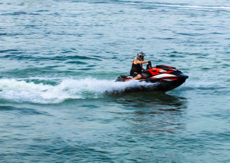 06 28 2019 Russia, Byansk. The pilot of the jet ski moves at high speed and enters the turn.