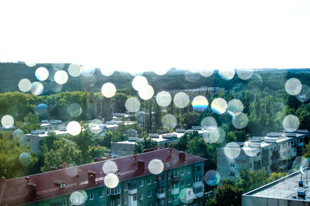 View from the window of a multi-storey building on the city through a curtain with sequins. Stock fotó - 137966626