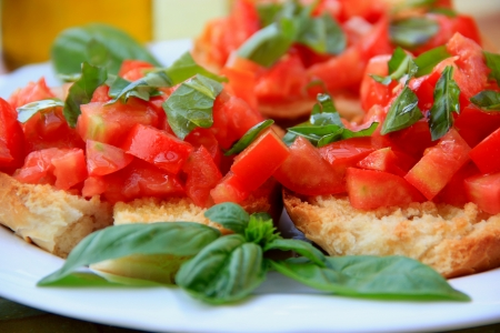 Fresh Tomato and  basil on a chopping board  photo
