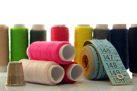 Spools of colored cotton thread to sew clothes and more photo