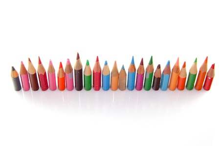 Orderly row  of short pencils of different colors photo