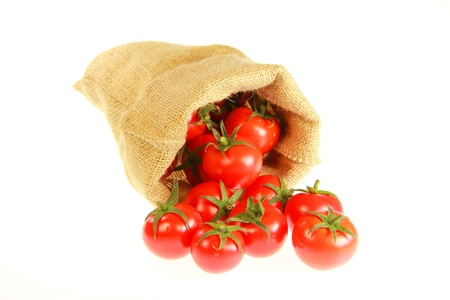 Jute bag fill of tomatoes with white background  photo