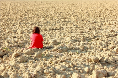A lonely children in a field of arable land Stock Photo - 16983617