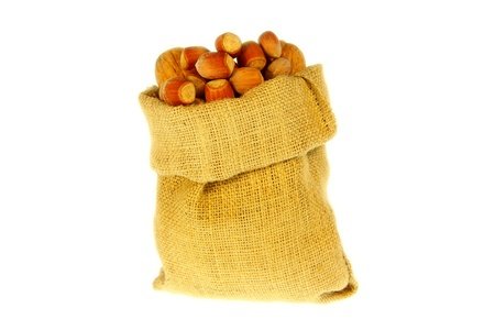 Jute bag full of walnuts and nuts with white background Stock Photo - 16983337