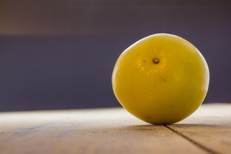 Grapefruit on the table in front of a window photo