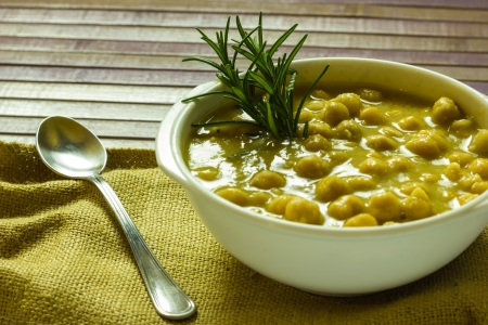 A bowl of chickpea soup on the table