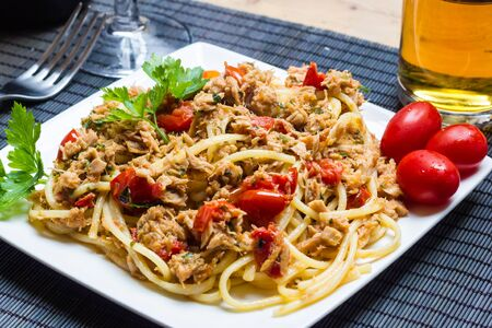 A plate of spaghetti with tuna