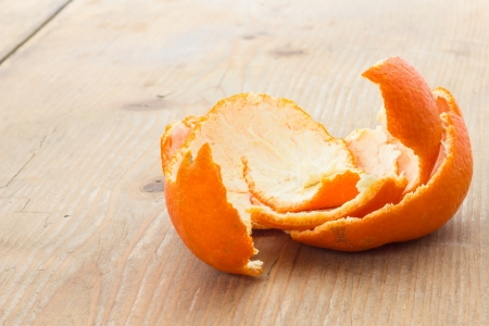 Tangerine peel on the table in front of a window photo
