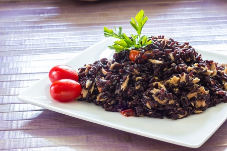 Black rice with tuna and tomatoes photo