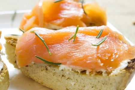 A plate of tarts with smoked salmon photo