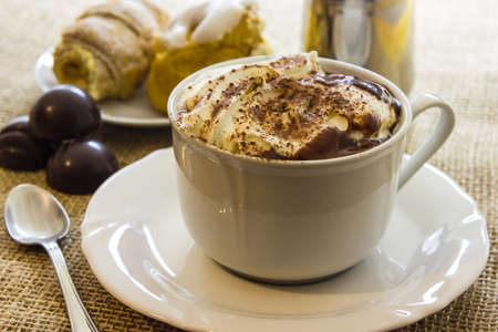 Hot chocolate cup with whipped cream photo