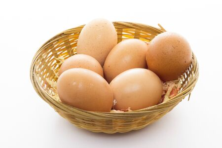 Some eggs in a basket with white background photo
