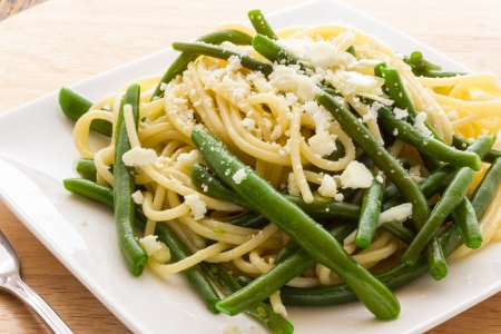 Spaghetti with garlic oil and green beans from Italy Stock Photo - 21997649