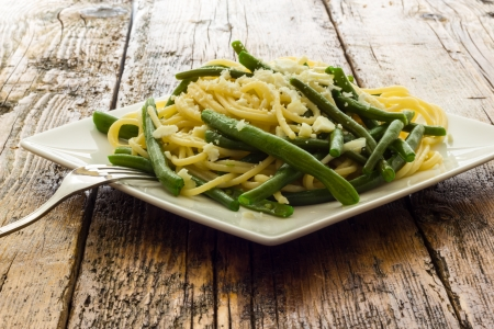Spaghetti with garlic oil and green beans from Italy Stock Photo