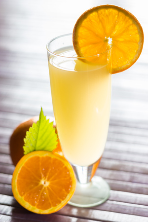 Fresh and colorful orange juice in a glass