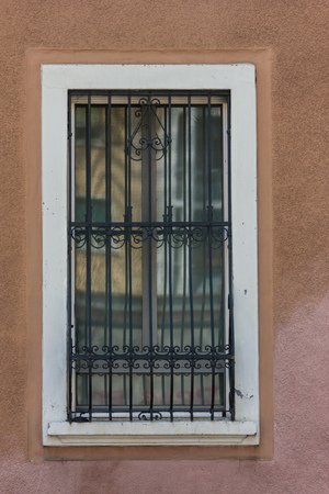grill pattern: Windows with iron bars  Stock Photo