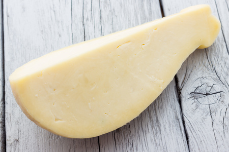 Slice of scamorza cheese from Italy photo