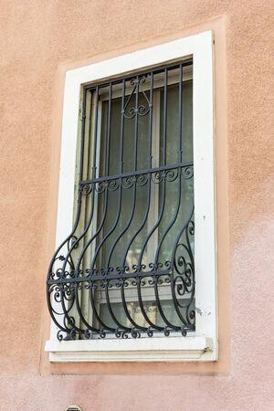 Windows with iron bars  Stock Photo