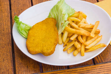 Cutlet with chips photo