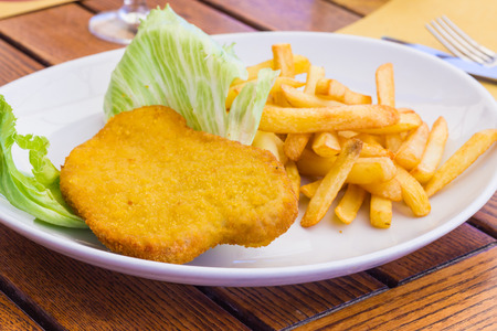 Cutlet with chips Stock Photo - 27433104