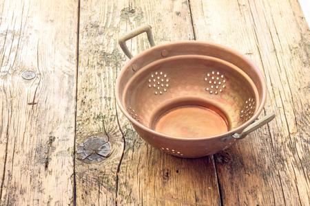 colander: old copper colander