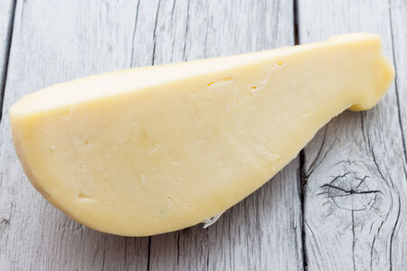scamorza cheese: Slice of scamorza cheese from Italy