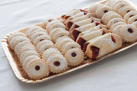 A mountain of sweet cookies with sugar photo