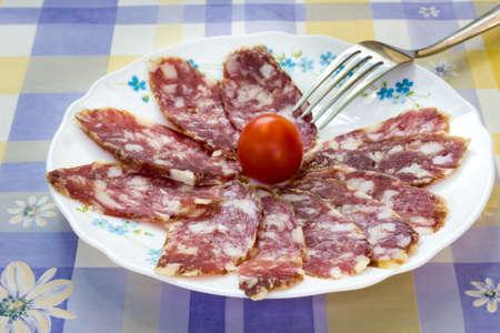 italian sausage: Slices of Italian sausage