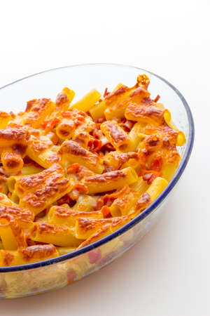 macaroni with cheese: Baked macaroni cheese with tomatoes and sausage Stock Photo
