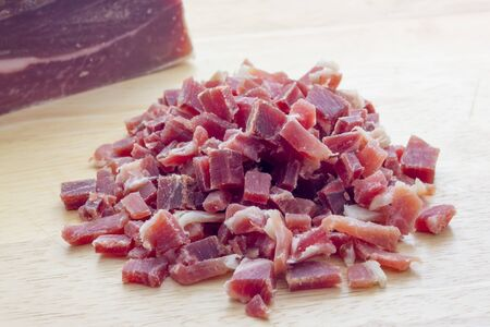 Raw diced bacon Фото со стока