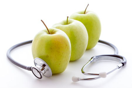 green apple: Stethoscope and apple