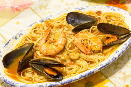 seafood dinner: Plate of tasty spaghetti with seafood Stock Photo