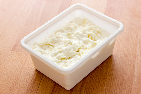 stracciatella: Stracciatella mozzarella from Italy Stock Photo