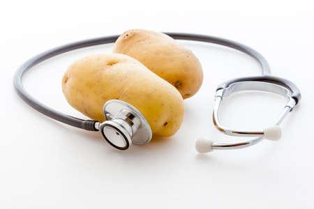 calory: Stethoscope and potato Stock Photo