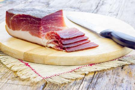 speck: Slices of tasty Italian Speck Stock Photo
