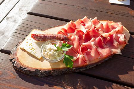 horseradish sauce: Speck salami and cheese with horseradish sauce Stock Photo